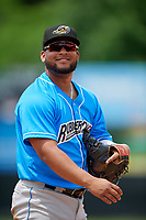 Akron RubberDucks first baseman Wilson Garcia (11) during an Eastern League game against the Bowie Baysox on May 30, 2019 at Prince George's Stadium in Bowie, Maryland.  Akron defeated Bowie 9-5.  (Mike Janes/Four Seam Images)
