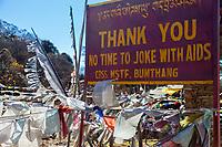 Trongsa, Bhutan.  AIDS Awareness Sign, Yotong Pass between Jakar and Trongsa.