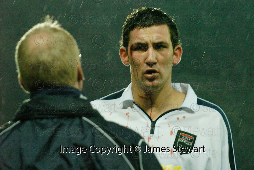 27/11/2004  Copyright Pic : James Stewart.File Name : jspa19_falkirk_v_ross_county.MARTIN CANNING IS TREATED FOR A HEAD INJURY JUST AS DANIEL MCBREEN SCORES FALKIRK'S EQUALISING FIRST GOAL.......Payments to :.James Stewart Photo Agency 19 Carronlea Drive, Falkirk. FK2 8DN      Vat Reg No. 607 6932 25.Office     : +44 (0)1324 570906     .Mobile   : +44 (0)7721 416997.Fax         : +44 (0)1324 570906.E-mail  :  jim@jspa.co.uk.If you require further information then contact Jim Stewart on any of the numbers above.........