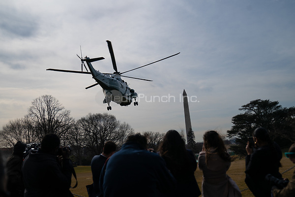 Marine One, with US President Joe Biden and first lady Jill Biden aboard, departs the White House aboard  in Washington, D.C., U.S., on Friday, Feb. 26, 2021. Biden is visiting Texas today to discuss recovery efforts after winter weather caused widespread damage and left millions without power. <br /> Credit: Erin Scott / Pool via CNP /MediaPunch
