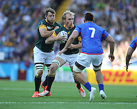 Schalk Burger of South Africa drives into Jack Lam of Samoa as Duane Vermeulen of South Africa supports during Match 15 of the Rugby World Cup 2015 between South Africa and Samoa - 26/09/2015 - Villa Park, Birmingham<br /> Mandatory Credit: Rob Munro/Stewart Communications