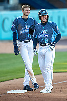West Michigan Whitecaps third baseman Spencer Torkelson (8) talks with teammate Parker Meadows (17) during a break in the action against the Great Lakes Loons at LMCU Ballpark on May 11, 2021 in Comstock Park, Michigan. The Loons defeated the Whitecaps in their home opener 9-1. (Andrew Woolley/Four Seam Images)