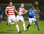 Hamilton Accies v St Johnstone...24.09.13      League Cup<br /> Nigel Hasselbaink tries to get round Ziggy Gordon and Martin Canning;<br /> Picture by Graeme Hart.<br /> Copyright Perthshire Picture Agency<br /> Tel: 01738 623350  Mobile: 07990 594431