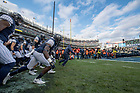 November 17, Coach Brian Kelly and players run onto the field before the Shamrock Series football game against Syracuse in Yankee Stadium, New York. (Photo by Barbara Johnston/University of Notre Dame)