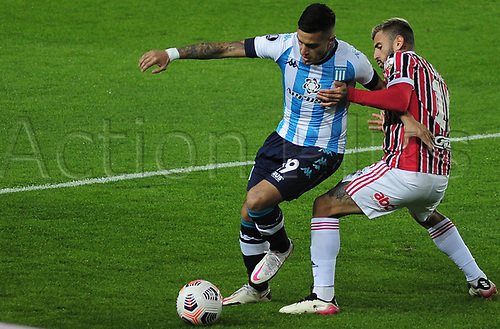 20th July 2021; Buenos Aires, Argentina;  Leonel Miranda of Racing challenged by Liziero do São Paulo, during the match between Racing and São Paulo, for the Libertadores 2021 Final Round, at Estádio Presidente Perón this Tuesday 20th.
