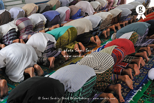People praying inside a mosque (Licence this image exclusively with Getty: http://www.gettyimages.com/detail/83154237 )