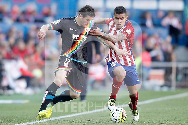 Atletico de Madrid's Angel Correa (r) and Rayo Vallecano's Piti during La Liga match. April 30,2016. (ALTERPHOTOS/Acero)