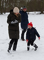A young family enjoy a snowball fight following snowfall at Foots Cray Meadow, Sidcup, Kent, England on the 9 February 2021. Photo by Alan Stanford.