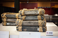 Suzhou, Jiangsu, China.  Exhibit Showing How Tiles were Wrapped for Shipping North on Boats to Beijing.  Suzhou Museum of Imperial Kiln Brick.