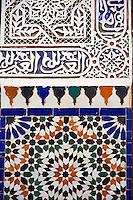 Berber Arabesque Morcabe plasterwok Zellige tiles of the Marrakesh museum in the Dar Menebhi Palace, Marrakesh, Morocco