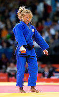 29 JUL 2012 - LONDON, GBR - Rosalba Forciniti (ITA) (in blue) of Italy celebrates winning her women's London 2012 Olympic Games -52kg bronze medal judo match against Marie Muller (LUX) of Luxembourg at the ExCel Exhibition Centre in London, Great Britain .(PHOTO (C) 2012 NIGEL FARROW)