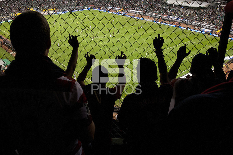 USA fans watch the USA vs. Mexico World Cup Qualifier at Azteca stadium in Mexico City, Mexico on March 26, 2013.