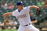 Round Rock Express starting pitcher Ross Wolf #15 delivers a pitch to the plate against the New Orleans Zephyrs in the Pacific Coast League baseball game on April 21, 2013 at the Dell Diamond in Round Rock, Texas. Round Rock defeated New Orleans 7-1. (Andrew Woolley/Four Seam Images).
