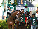July 5, 2014: Delaware Oaks contender Aibhilin (#5, Edwin Rivera up), owned by David and Margaret Wimer and trained by Cathal Lynch, walks in the paddock before the race. Fortune Pearl, trained by Graham Motion and ridden by Trevor McCarthy, wins the Grade II Delaware Oalks at Delaware Park in Stanton Delaware. She is owned by Lawrence Stable Inc. © Joan Fairman Kanes/ESW/CSM