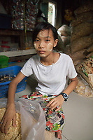 """Ma Phyu*, 14 years, packaging dry noodles. She is employed by Nila* and her husband who run a home-based business baking cakes and packaging dry noodles which are sold in local markets. """"We work about 10 hours a day and support our families who live in a village nearby with our income. We all live together here and share a room upstairs in the house. It´s ok for us to do this work and we don`t find it too tiring."""""""