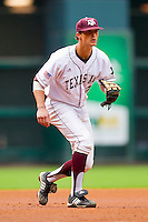 Third baseman Adam Smith #20 of the Texas A&M Aggies on defense against the Utah Utes at Minute Maid Park on March 4, 2011 in Houston, Texas.  Photo by Brian Westerholt / Four Seam Images