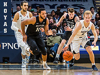 WASHINGTON, DC - JANUARY 28: Bryce Nze #10 of Butler pursues Mac McClung #2 of Georgetown during a game between Butler and Georgetown at Capital One Arena on January 28, 2020 in Washington, DC.
