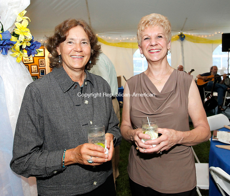 Sharon, CT-10 August 2012-081012CM05-  Left to right, Jan Dudek of Sharon and Marilyn Hocki, of Sharon and the designer of the decorations of the event, during the Sharon Audubon and Miles Wildlife Sanctuary's 50th anniversary celebration in Sharon.       Christopher Massa Republican-American