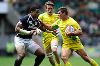 Ed Jenkins of Australia comes up against Andrew Durutalo  of the United States during the iRB Marriott London Sevens at Twickenham on Saturday 11th May 2013 (Photo by Rob Munro)