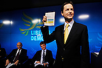 Liberal Democrat Party leader Nick Clegg launches his party's manifesto for the 2010 general election in London, with his deputy Vince Cable watching on (left).