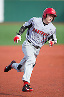 Sebastian DiMauro (20) of the Hartford Hawks hustles towards third base against the Virginia Cavaliers at The Ripken Experience on February 27, 2015 in Myrtle Beach, South Carolina.  The Cavaliers defeated the Hawks 5-1.  (Brian Westerholt/Four Seam Images)
