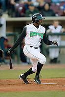 Byron Wiley #15 of the Dayton Dragons follows through on his swing versus the Great Lakes Loons at Fifth Third Field April 22, 2009 in Dayton, Ohio. (Photo by Brian Westerholt / Four Seam Images)