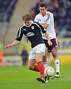 Falkirk's Jay Fulton holds off Hearts' Ryan McGowan.