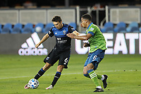 SAN JOSE, CA - OCTOBER 18: Shea Salinas #6 of the San Jose Earthquakes is defended by Jordy Delem #8 of the Seattle Sounders during a game between Seattle Sounders FC and San Jose Earthquakes at Earthquakes Stadium on October 18, 2020 in San Jose, California.