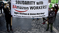 NEW YORK, NEW YORK - FEBRUARY 20: People attend a demonstration against Amazon working politics on February 20, 2021 in New York. New York state's attorney general sued Amazon, claiming that failed to adequately protect its workers from risks during the Covid-19 pandemic.  (Photo by John Smith/VIEWpress via Getty Images)