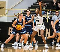 Caylan Koons (5) of Spring Har-ber looking to drive to the basket runs into Maryam Dauda  (30) of Bentonville at Tiger Arena, Bentonville, AR January 5, 2021 / Special to NWA Democrat-Gazette/ David Beach