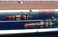 Apr. 1, 2011; Las Vegas, NV, USA: NHRA top fuel dragster driver Larry Dixon (left) races alongside David Grubnic during qualifying for the Summitracing.com Nationals at The Strip in Las Vegas. Mandatory Credit: Mark J. Rebilas-
