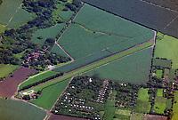 aerial photograph grass strip runway at agricultural fields in Nicaragua | Fotografía aérea de la pista de aterrizaje de la franja de césped en los campos agrícolas de Nicaragua