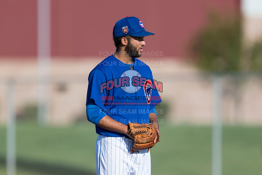 AZL Cubs 1 starting pitcher Jesus Tejada (55) gets ready to deliver a pitch during an Arizona League game against the AZL Indians 1 at Sloan Park on August 27, 2018 in Mesa, Arizona. The AZL Cubs 1 defeated the AZL Indians 1 by a score of 3-2. (Zachary Lucy/Four Seam Images)