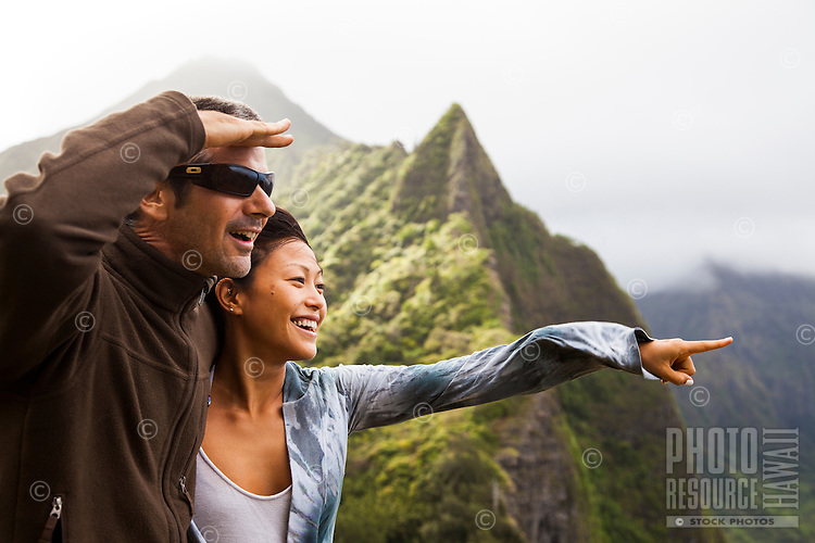 Happy couple trail hiking and sightseeing in Windward Oahu.