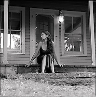 Woman sitting on front porch