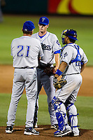 Stephen Dodson (19) of the Tulsa Drillers talks with pitching coach Dave Schuler (21) and Wilin Rosario (20) on the mound during a game against the Springfield Cardinals at Hammons Field on July 18, 2011 in Springfield, Missouri. Tulsa defeated Springfield 13-8. (David Welker / Four Seam Images)