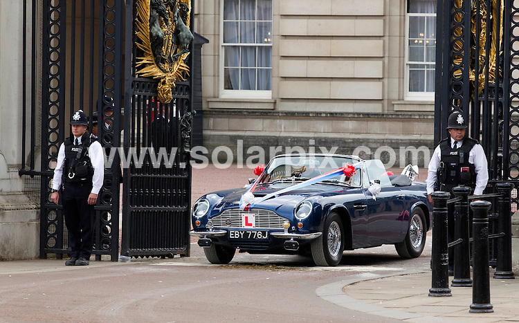 **ALL ROUND PICTURES FROM SOLARPIX.COM**                                                                                                                            Caption: Prince William took his new wife Kate Middleton for a drive around The Mall in his dad's Aston Martin  with the number plate 'Just Wed'London, UK. 29 April 2011                                                                              This pic: Prince William and Kate Middleton                                          JOB REF: 13238 CPT      DATE: 29_04_2011                                                           **MUST CREDIT SOLARPIX.COM OR DOUBLE FEE WILL BE CHARGED**                                                                      **MUST AGREE FEE BEFORE ONLINE USAGE**                               **CALL US ON: +34 952 811 768 or LOW RATE FROM UK 0844 617 7637**