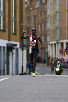 3rd October 2021; London, England: The Virgin Money 2021 London Marathon: Pace maker runner waving to cheering spectators at Narrow Street Swing Bridge, Limehouse Basin between mile 14 and 15.