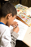Education Elementary school Grade 2 English language arts test male student at work at desk vertical