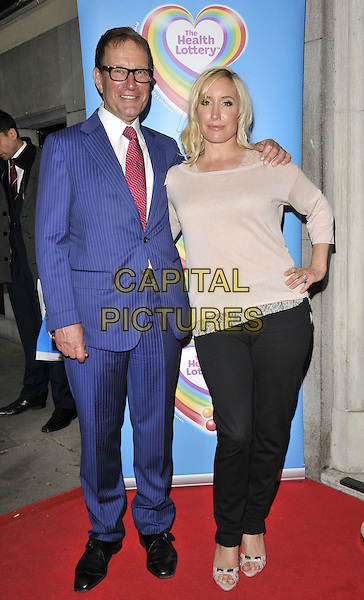 LONDON, ENGLAND - JUNE 02: Richard Desmond & Joy Desmond ( nee Canfield ) attend the Health Lottery VIP tea party, The Savoy Hotel, The Strand, on Monday June 02, 2014 in London, England, UK.<br /> CAP/CAN<br /> ©Can Nguyen/Capital Pictures