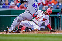 15 April 2018: Washington Nationals outfielder Michael A. Taylor slides home safely on a passed ball in the 5th inning against the Colorado Rockies at Nationals Park in Washington, DC. All MLB players wore Number 42 to commemorate the life of Jackie Robinson and to celebrate Black Heritage Day in pro baseball. The Rockies edged out the Nationals 6-5 to take the final game of their 4-game series. Mandatory Credit: Ed Wolfstein Photo *** RAW (NEF) Image File Available ***