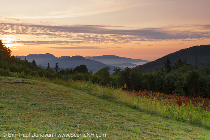 Sunrise over the White Mountains from the C.L. Graham Wangan Grounds Scenic Overlook along the Kancamagus Highway (route 112) in the White Mountains, New Hampshir during the summer months. The Kancamagus Highway is one of New England's scenic byways.