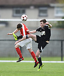 Darren Cullinan of Newmarket Celtic in action against Keith Maudsley of Janesboro during their Munster Junior Cup semi-final at Limerick. Photograph by John Kelly.