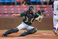 Catcher Eric Fryer #34 of the Lynchburg Hillcats dives to tag out Greg Paiml #3 of the Winston-Salem Dash at home plate at Wake Forest Baseball Stadium August 30, 2009 in Winston-Salem, North Carolina. (Photo by Brian Westerholt / Four Seam Images)