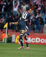 The USA's Landon Donovan reacts to scoring the first USA goal with teammate Clint Dempsey in the second half of the 2010 World Cup match between USA and Slovenia at Ellis Park Stadium in Johannesburg, South Africa on Friday, June 18, 2010.  The USA tied Slovenia 2-2.