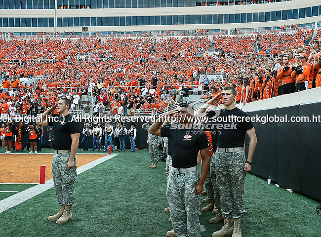 Oklahoma State Cowboys ROTC unit salutes during the game between the Louisiana-Lafayette Ragin Cajuns and the Oklahoma State Cowboys at the Boone Pickens Stadium in Stillwater, OK. Oklahoma State defeats Louisiana-Lafayette 61 to 34.
