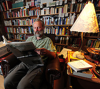 George Zens' office is lined with research materials that he uses to publish Sustainable Times. He relaxes here on Saturday at his home office in Middleton, Wisconsin
