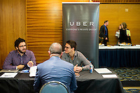 Matthew Coley, a Navy veteran from Somerville, Massachusetts, speaks with Uber representatives who asked not to be named at the Recovering Warrior Employment Conference at the Back Bay Event Center in Boston, Massachusetts, USA. The employment conference was organized by Hiring Our Heroes and Wounded Warrior Project. Hiring Our Heroes is an initiative of the US Chamber of Commerce Foundation. Approximately 40 veterans registered for the event, during which they had interviews with a number of different regional and national employers, including GE, Bank of America, Uber, and others.