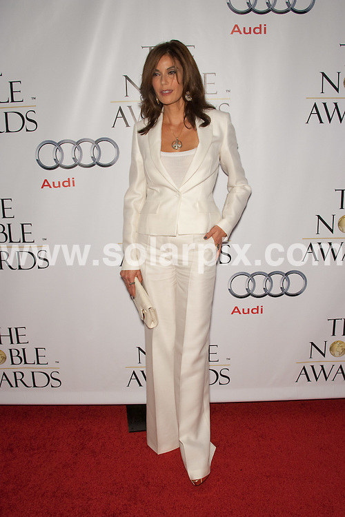 **ALL ROUND PICTURES FROM SOLARPIX.COM**.**SYNDICATION RIGHTS FOR UK, AUSTRALIA, DENMARK, PORTUGAL, S. AFRICA, SPAIN & DUBAI (U.A.E) ONLY**.Arrivals for the 1st Annual The Noble Awards. Held at the Beverly Hills Hilton, Beverly Hills, CA, USA. 18 October 2009..This pic: Teri Hatcher..JOB REF: 10150 PHZ Hatcher   DATE: 18_10_2009.**MUST CREDIT SOLARPIX.COM OR DOUBLE FEE WILL BE CHARGED**.**MUST NOTIFY SOLARPIX OF ONLINE USAGE**.**CALL US ON: +34 952 811 768 or LOW RATE FROM UK 0844 617 7637**