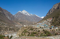 Nepal The village of Thamo rising up into a hill with the Himalayas in the backgrounds remote, Mt Everest, Himalayas